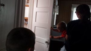 """Our daughter being silly, attempting to give one of our sons a """"swirly."""""""